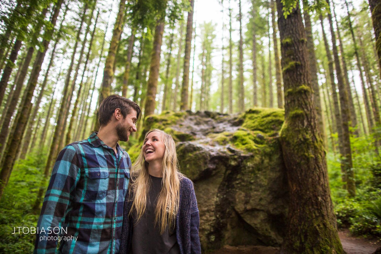 Couple laughs hiking engagement shoot photo