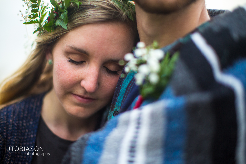 woman leans into man engagement shoot photo