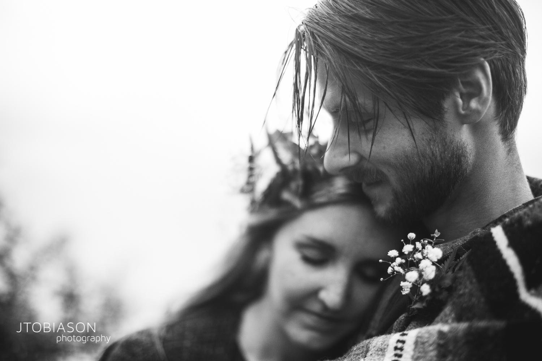 man smiles at woman engagement shoot photo