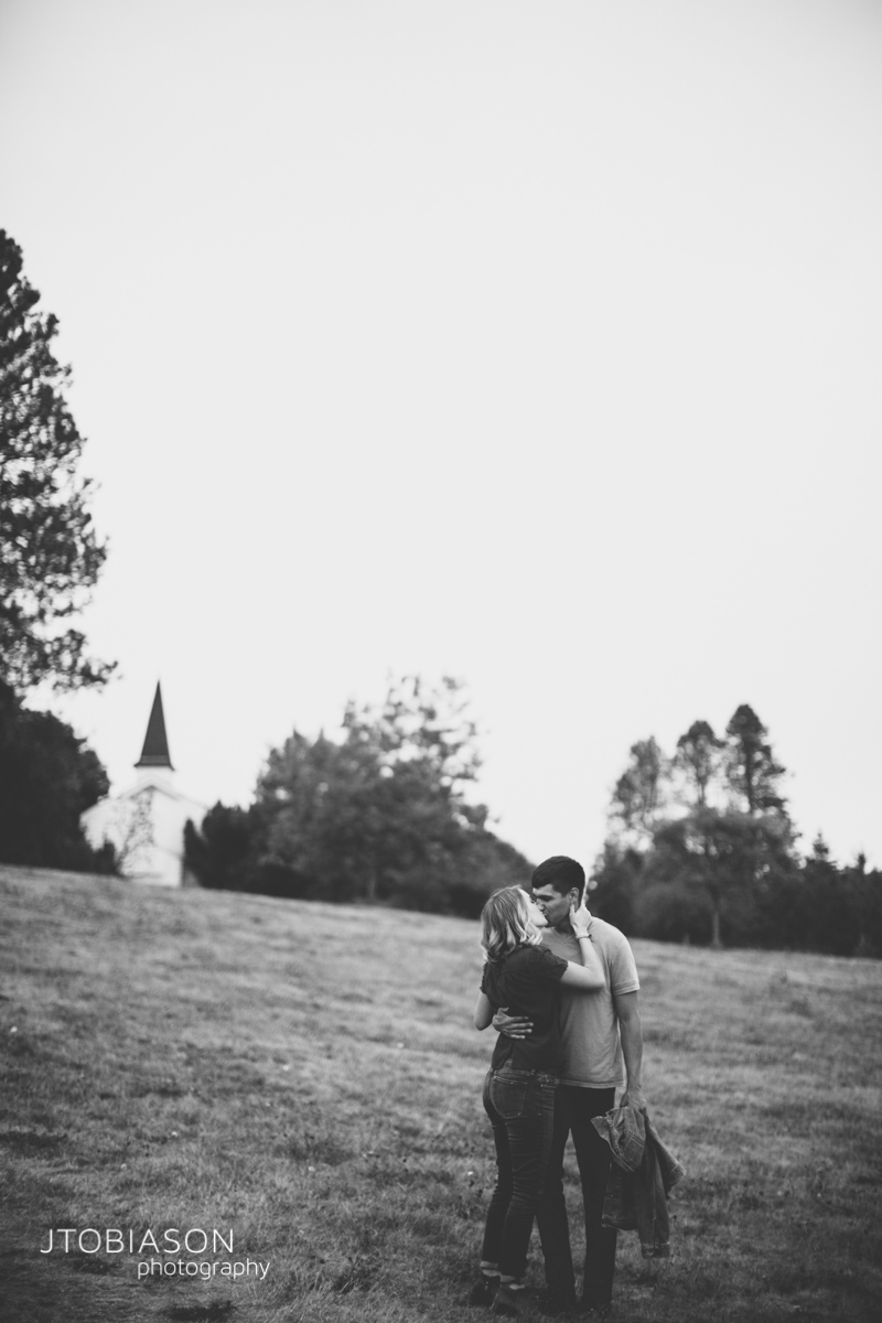 Couple kiss Discovery Park Engagement photo