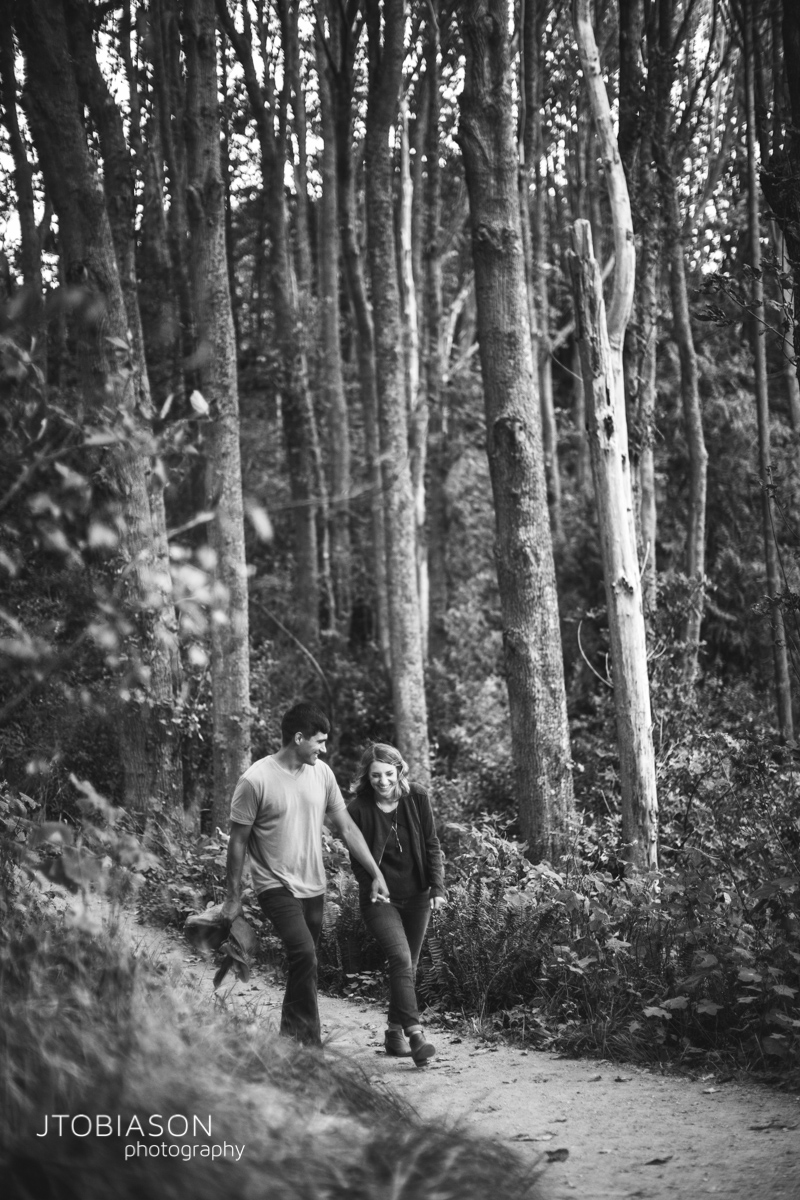 Couple walks in the woods photo