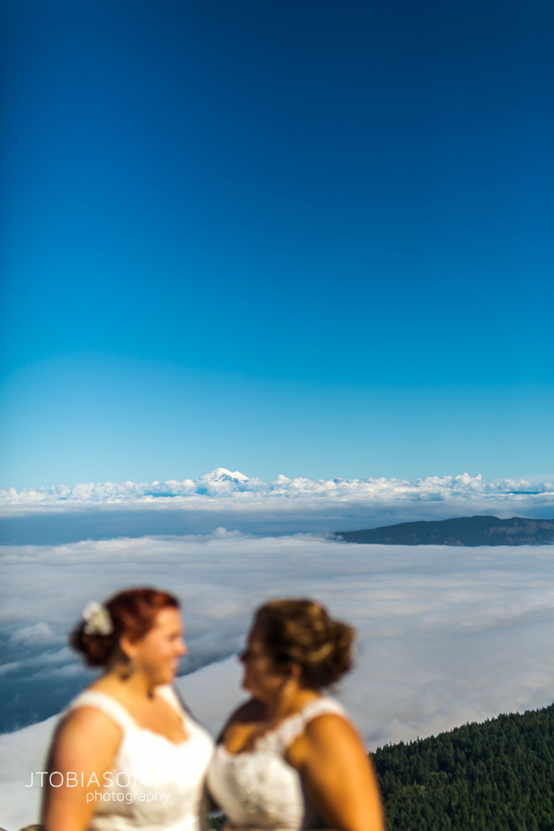 brides with view from mt constitution photo