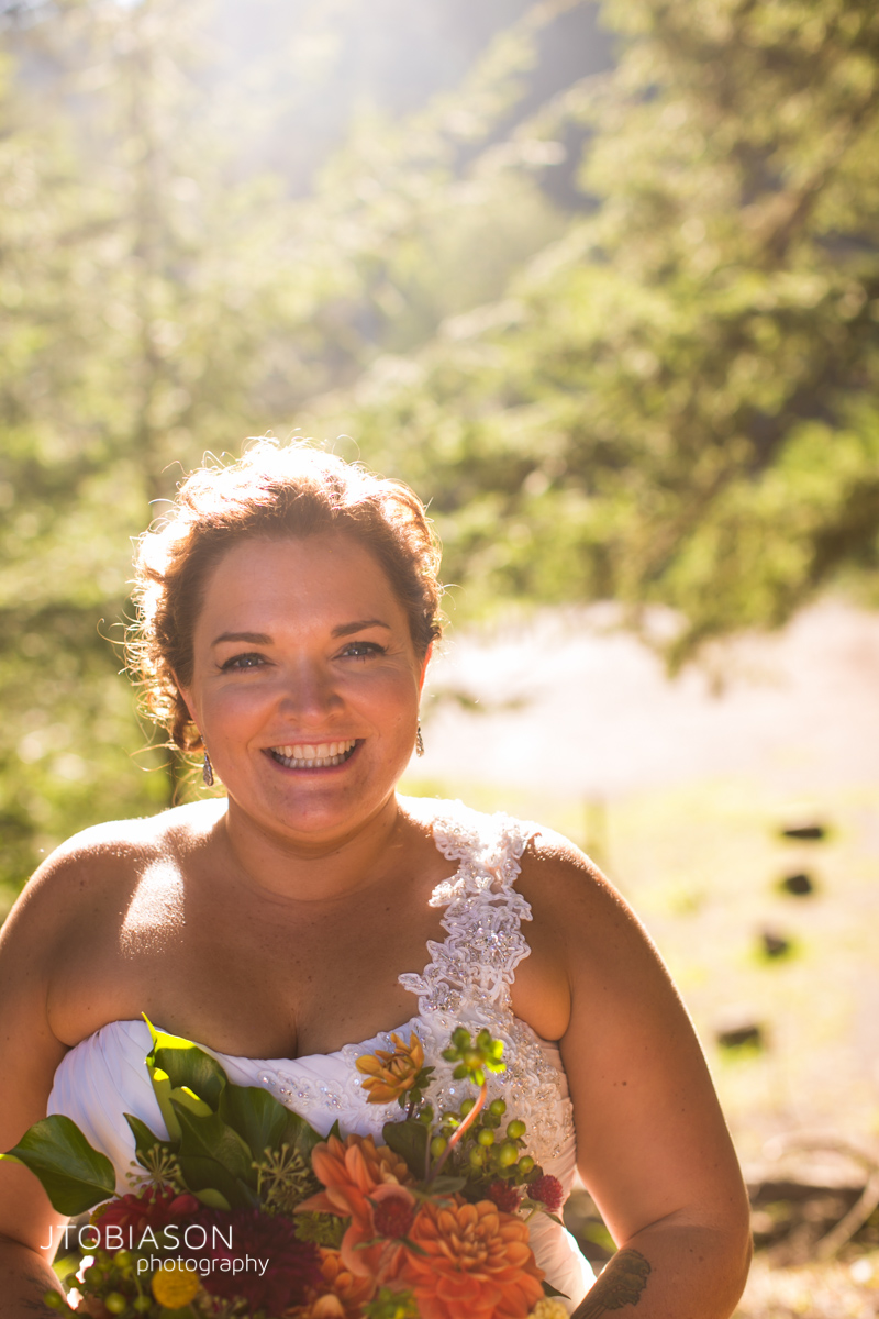 bride smiles in the sunset photo