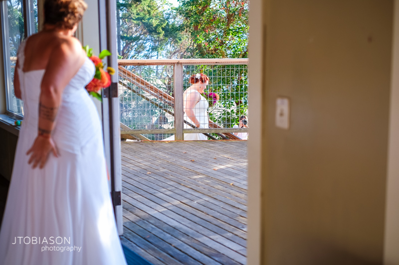 Brides walk down the stairs at Odd Fellows Hall photo