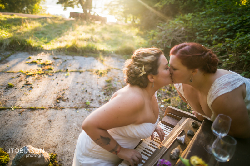 Brides kiss in the sunset photo