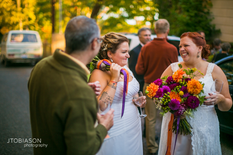 Brides laugh together outside odd fellows hall photo