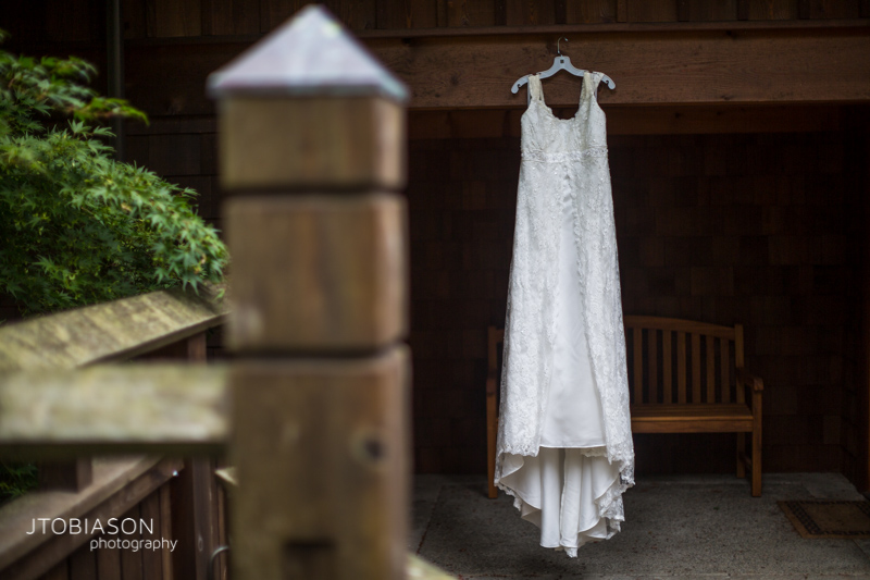 Bride's dress hangs outside photo