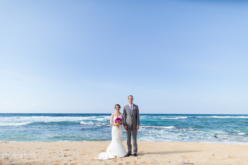 Coouple poses on beach kauai destination wedding