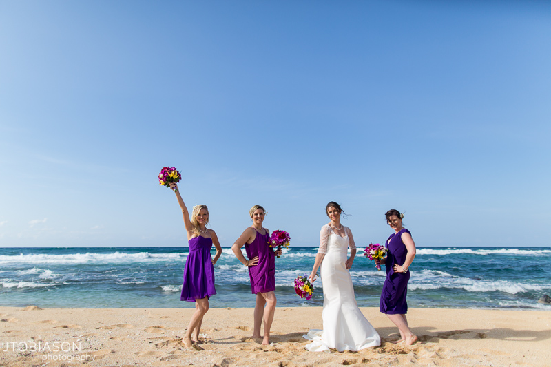 bridesmaids pose on beach
