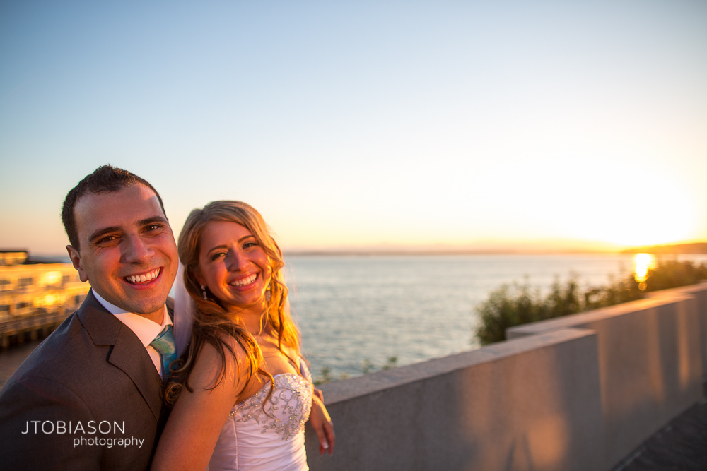 Couple smiles in the sunset at the Sculpture park photo