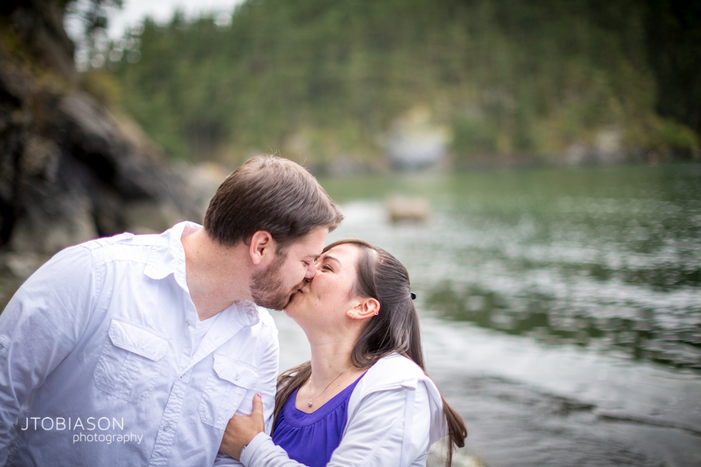 Couple kiss Deception Pass Engagement
