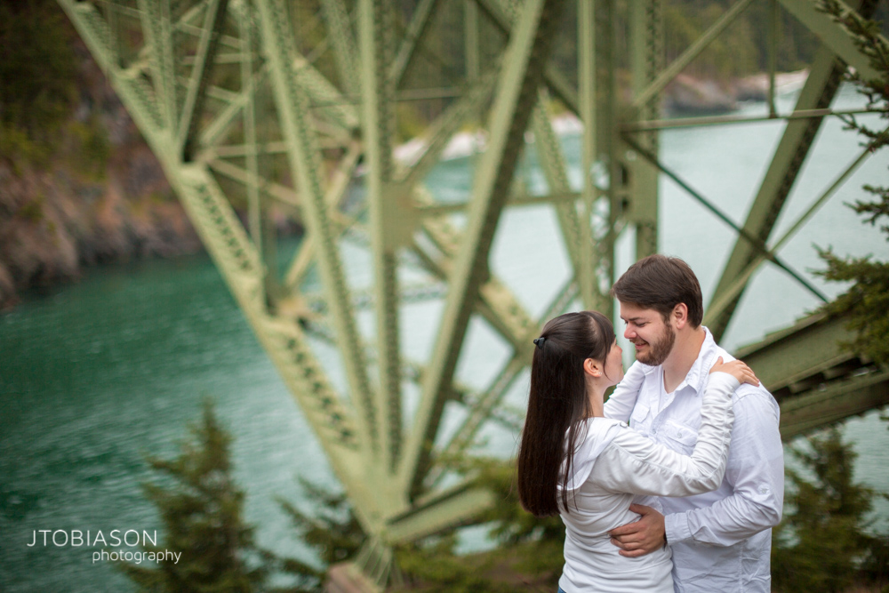 Couple pose together Deception Pass Engagement