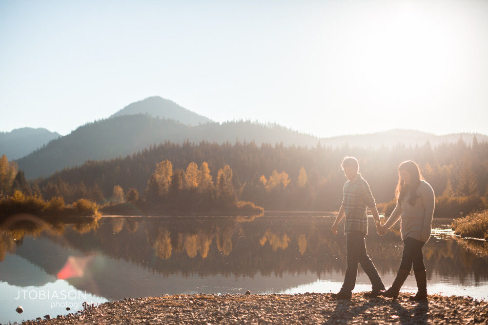 Couple walk in the sunset snoqualmie pass engagement