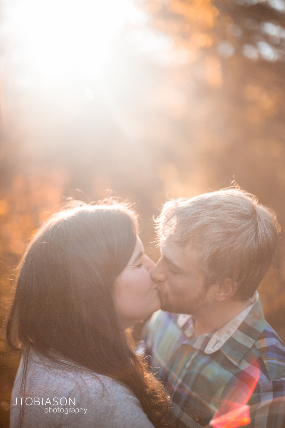couple kiss in sunset