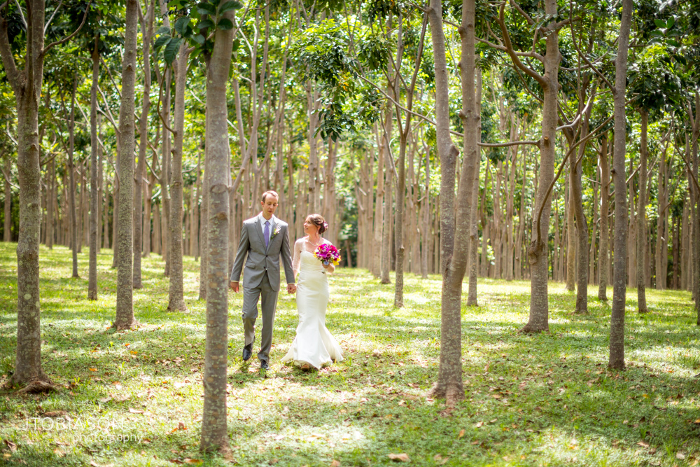 Bride and groom walk in the woods photo