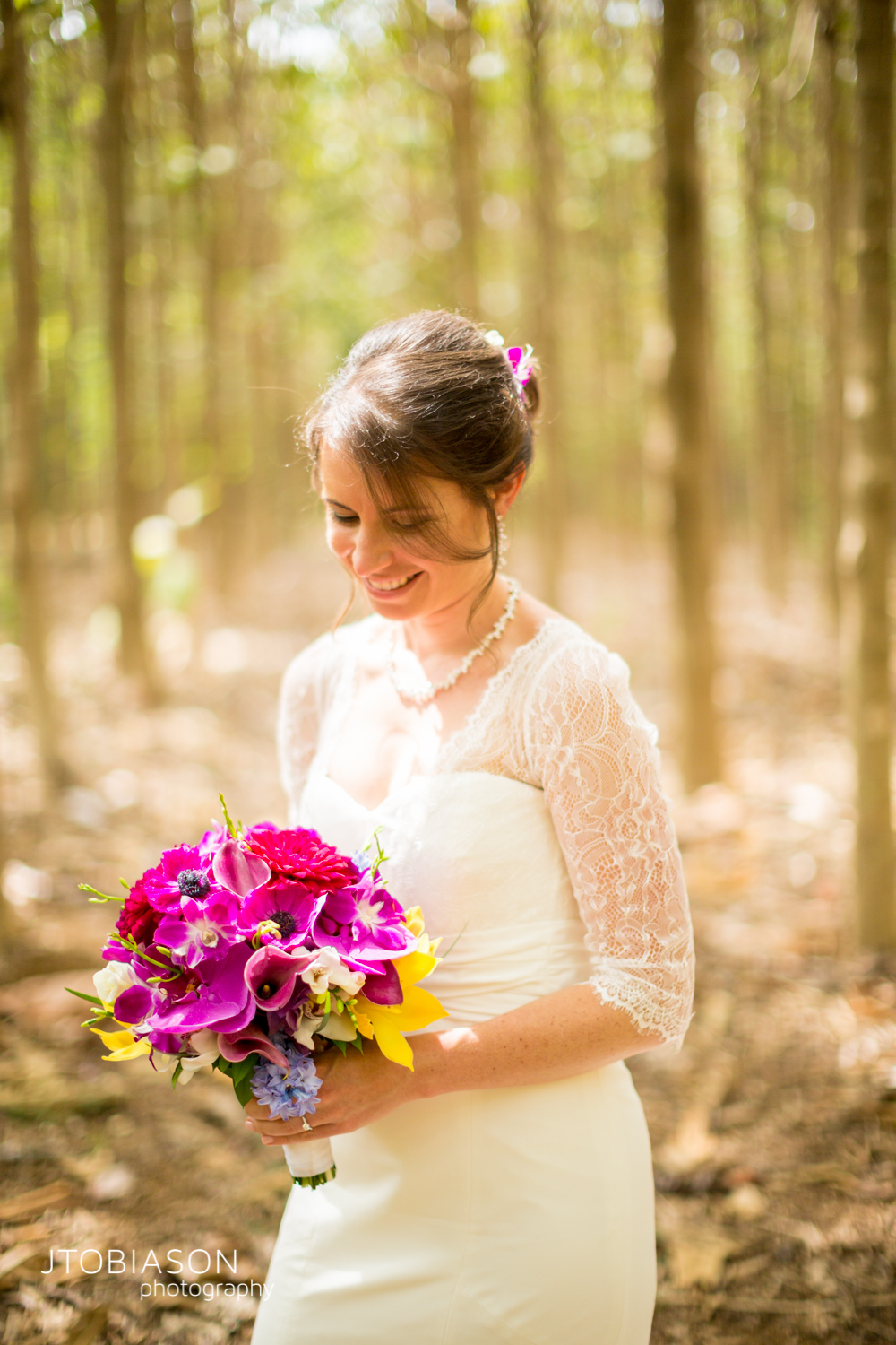 Bride smiles with bouquet photo