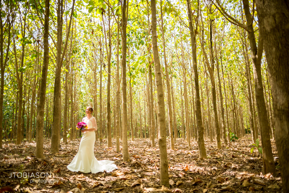 Bride stands in the woods Kauai Beach Wedding photo