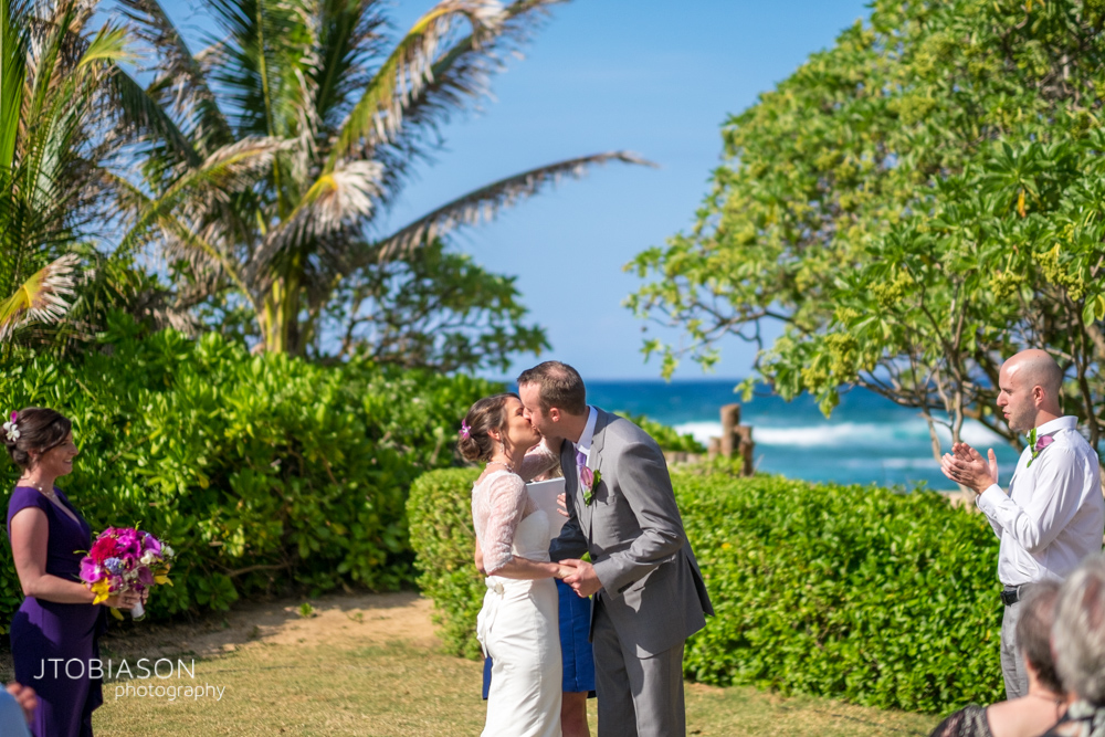 first kiss Kauai Beach Wedding photo