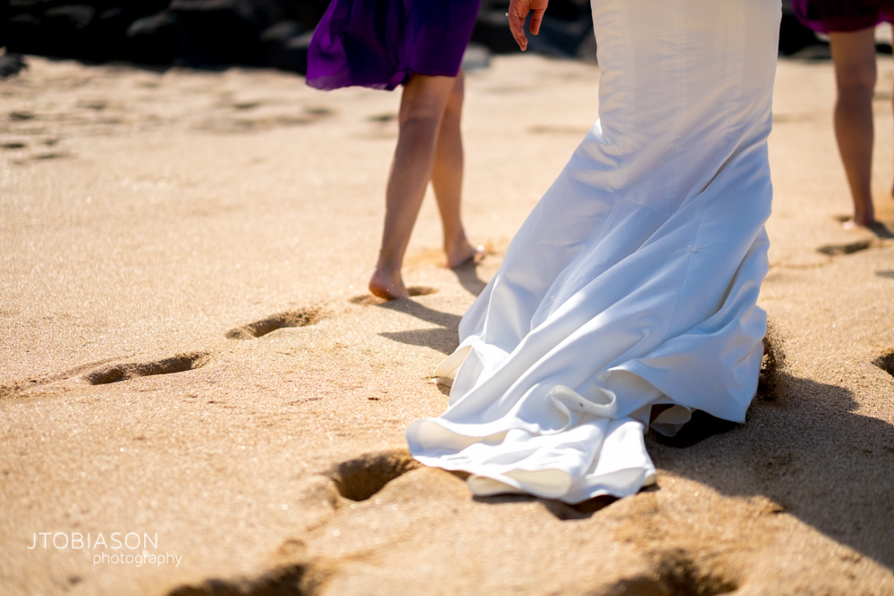 Bride walks on the beach photo