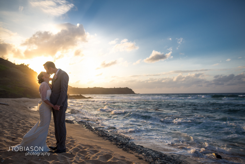 couple kisses kauai Beach wedding Destination photo