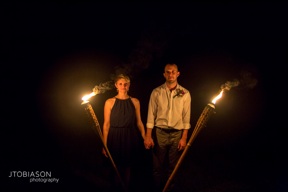 Couple poses between lanterns photo