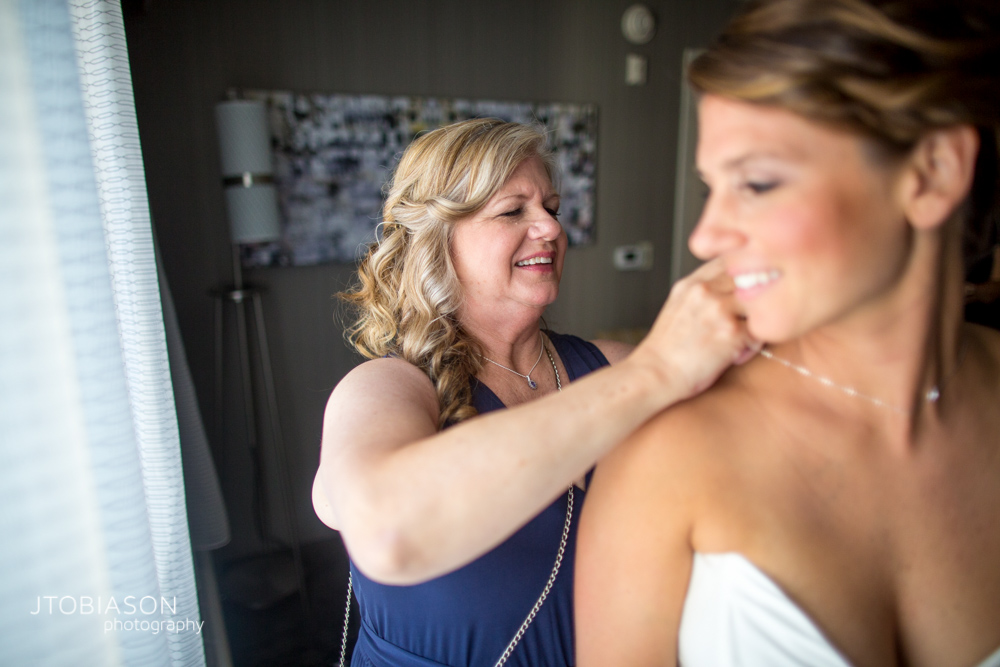 Bride gets ready with her mom photo
