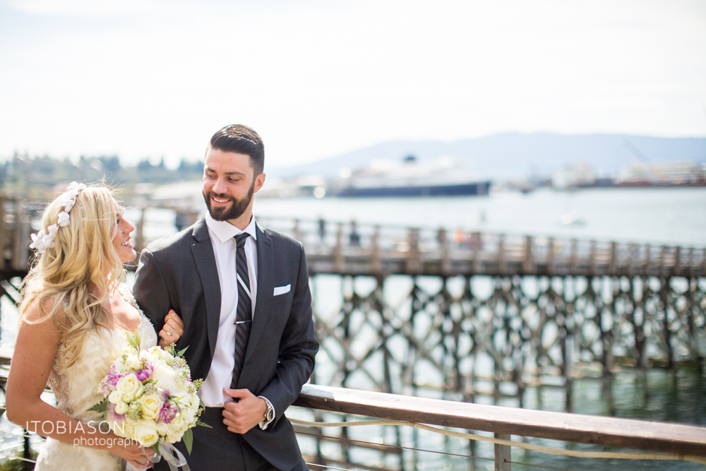 12 - Bride and groom smile at eachother photo
