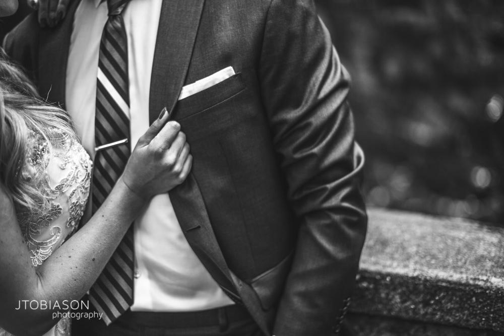 17 - Bride pulls on groom's jacket black white bellingham fall wedding photo