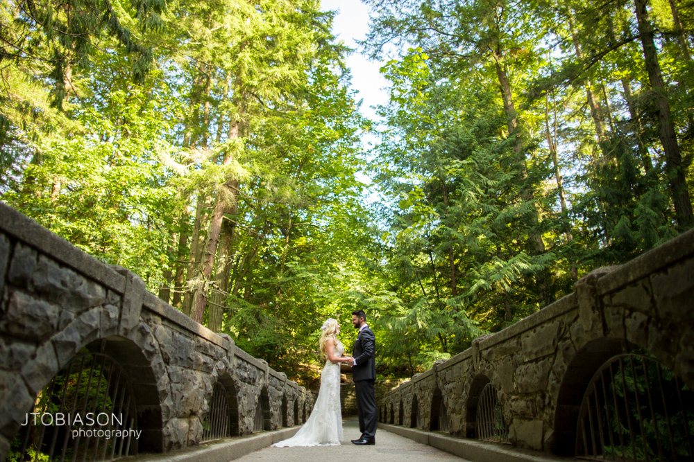 19 - Bride and groom stand on bridge Bellingham Fall Wedding photo
