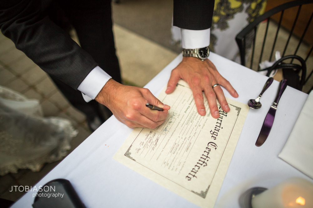 33 - couple signs marriage certificate photo