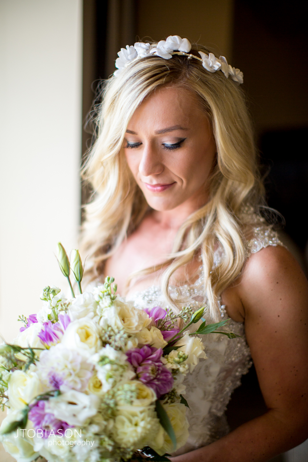 8 - Bride smiles at bouquet Bellingham Fall Wedding photo
