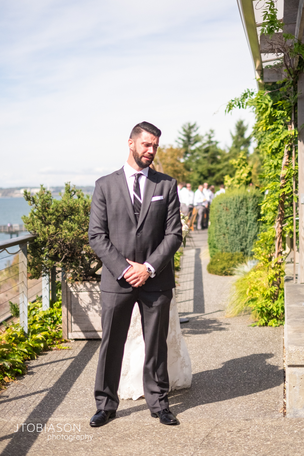 9 - Groom waits for bride photo