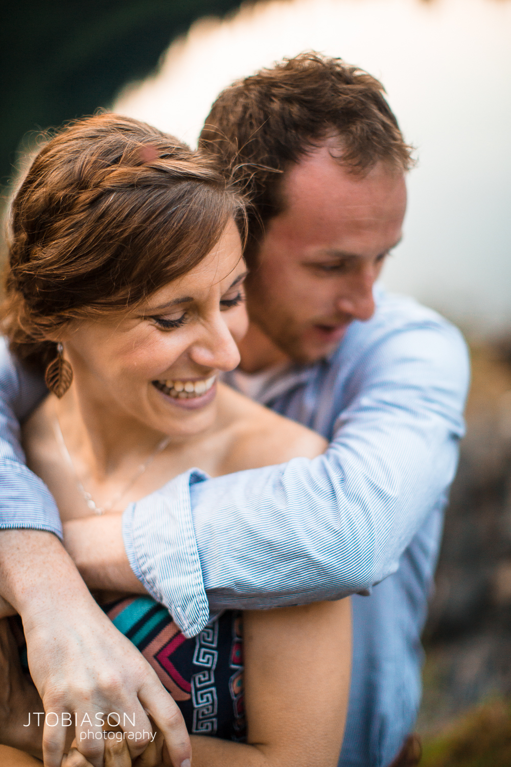 32 - Woman smiles with man Lake 22 Engagement photo