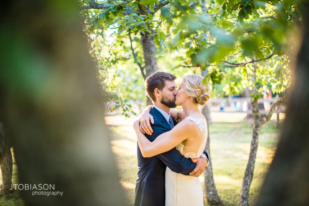10 - Bride and groom kiss Inn at Ship Bay Wedding photo