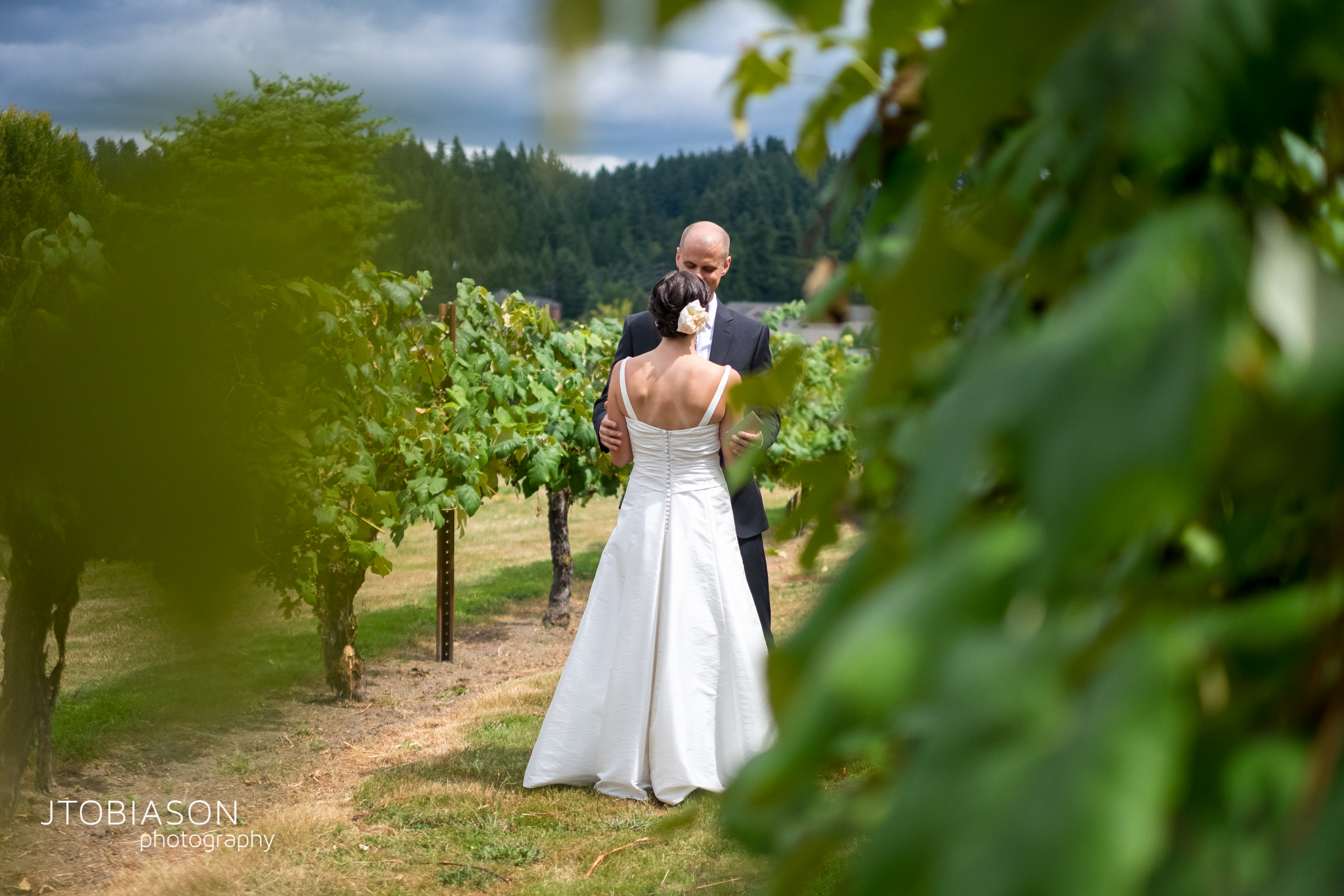 5 - Bride and groom stand in vineyard Hollywood Schoolhouse WEdding photo