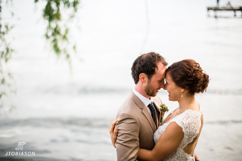 Bride and groom kiss Golden gardens boathouse wedding