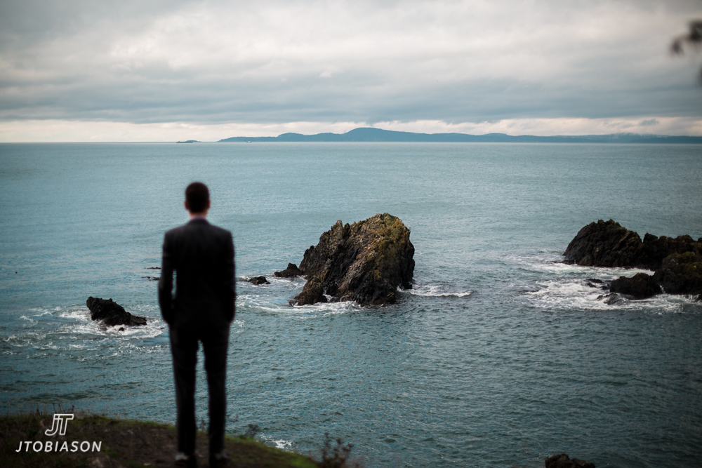 Groom looks out on rocks