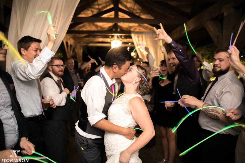 couple kisses under glow sticks