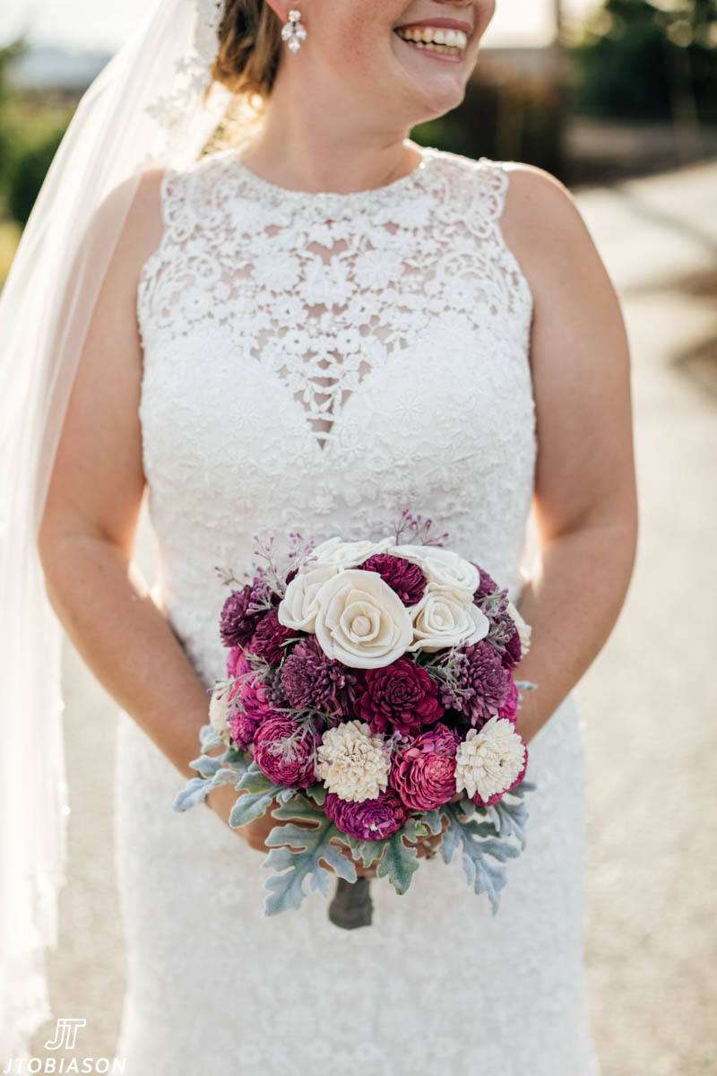 bride holds bouquet hidden meadows wedding
