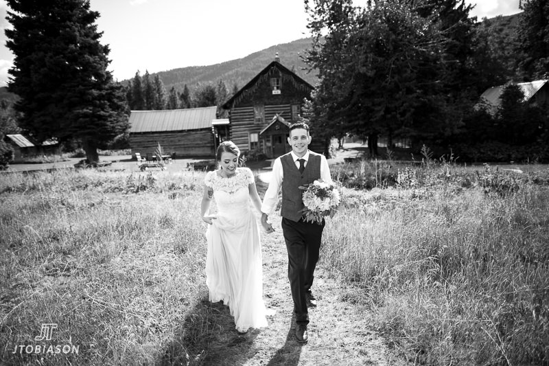 bride and groom walk up hill