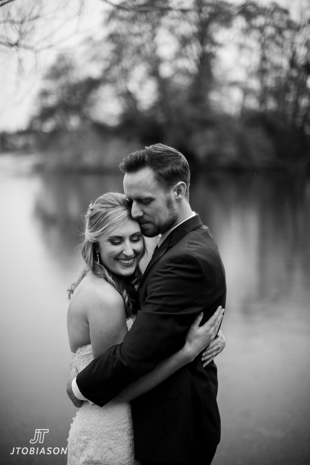 bride and groom huddle to stay warm great hall at green lake wedding photo