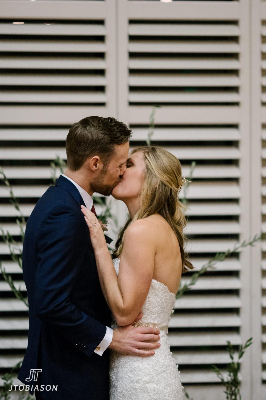 first kiss great hall at green lake wedding photo