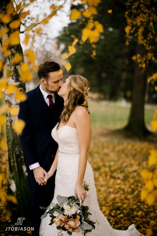 bride and groom kiss great hall at green lake wedding photo
