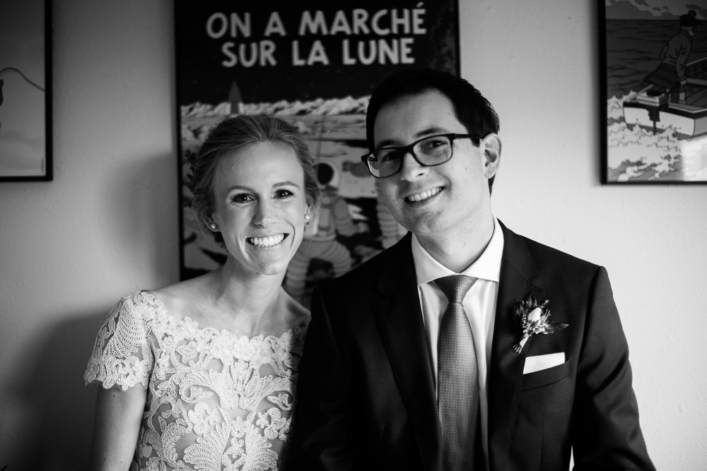 bride and groom smile with joy black and white