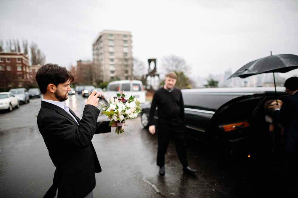 man takes photo of limo downtown seattle elopement