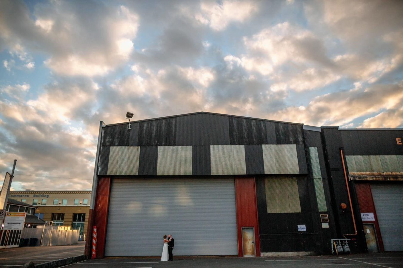 couple kisses in front of garage westland whiskey wedding
