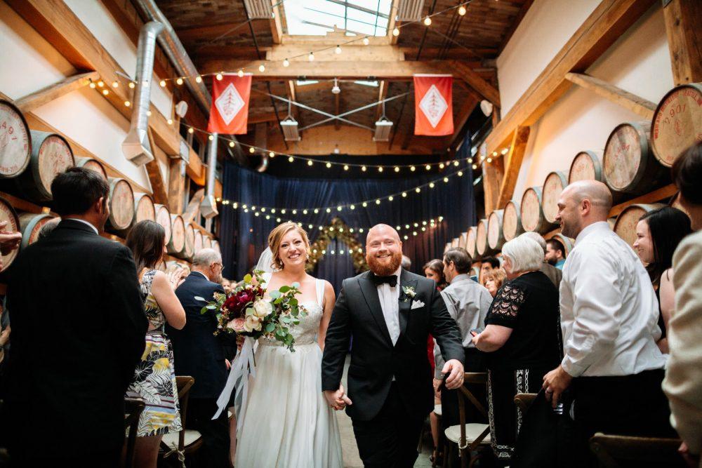 groom and bride walk back down aisle westland whiskey wedding