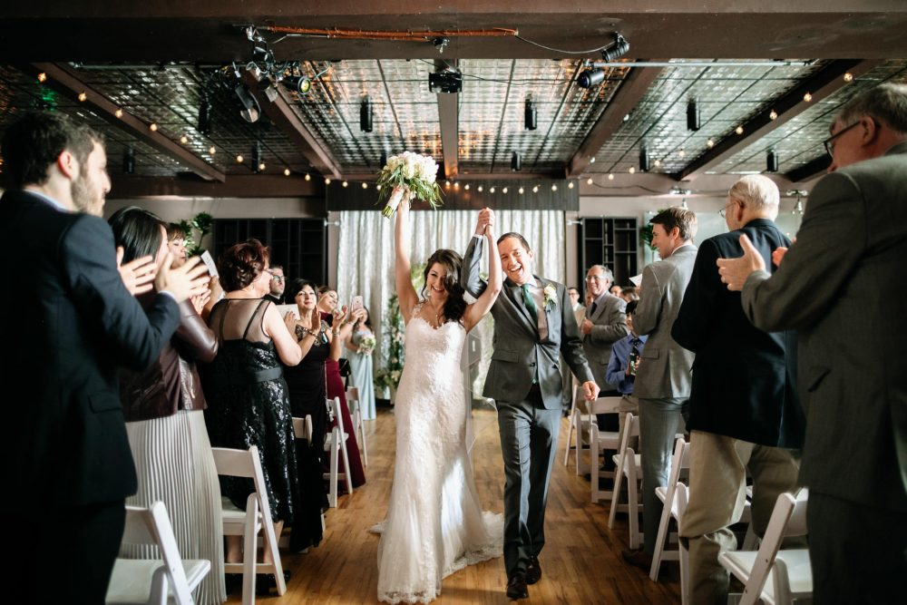 couple celebrates walking down aisle