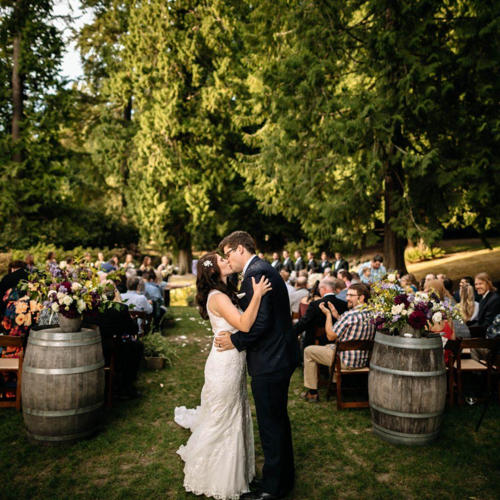 couple kisses delille cellars wedding