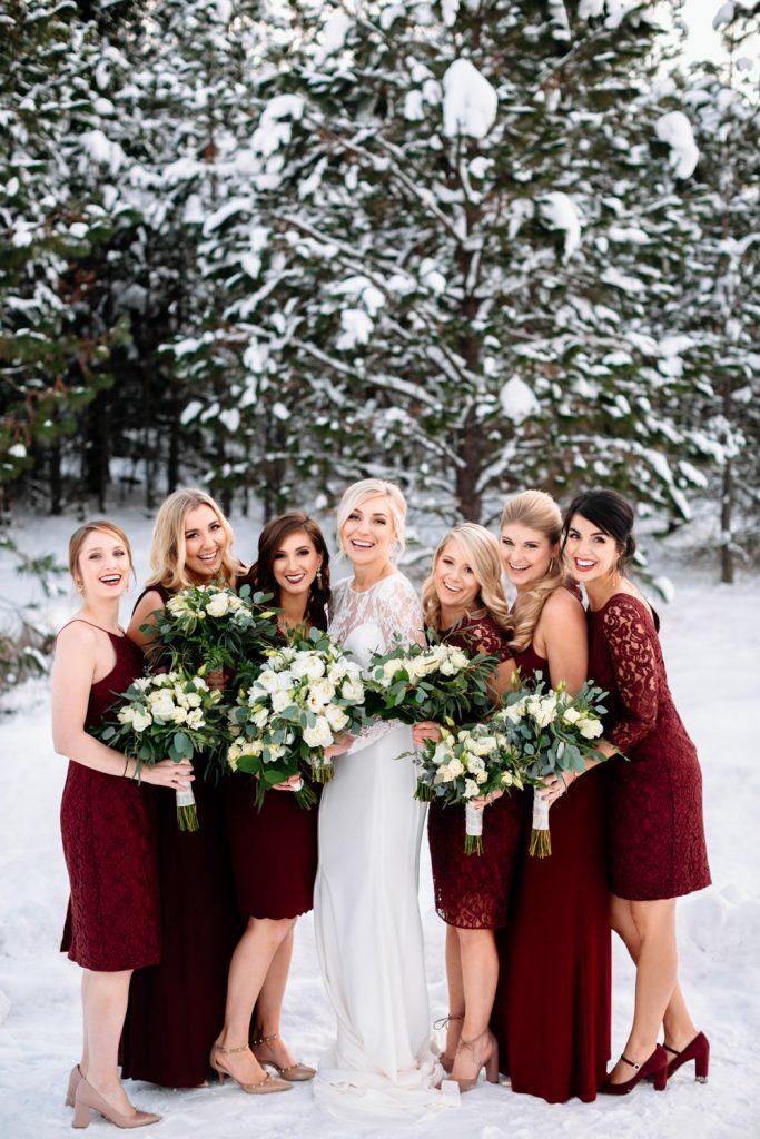 bride and groom walk through the woods sisters oregon wedding
